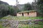 Pequeña casa de piedra con gran depósito de agua en ubicación privilegiada en Fornalutx